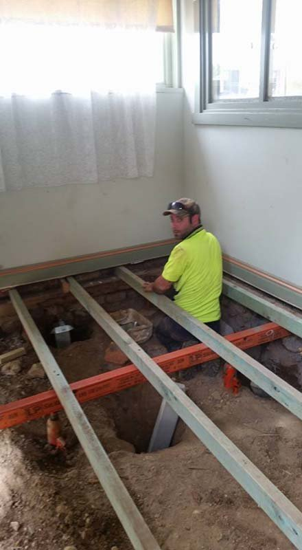 man standing in house foundation