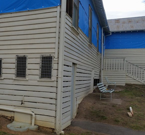 side of commercial building being repaired