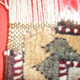 riparazione tappeto udine, restauro bordatura, restauro frange udine, riparazione tappeto antico, telaio tappeto, trama e ordito