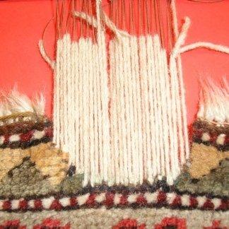 ricostruzione tappeto, telaio tappeto, restauro frangia udine, laboratorio restauro udine