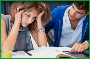 Male and female student with text books