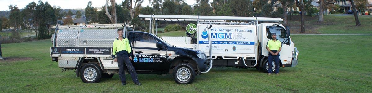 mg mangan plumbing workers and truck