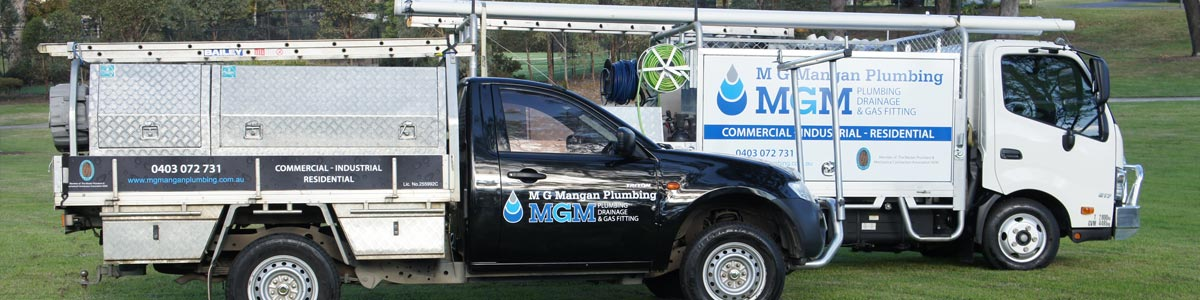 mg mangan plumbing two truck over green grass