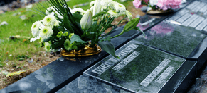 Lawn plaques and memorials with flowers