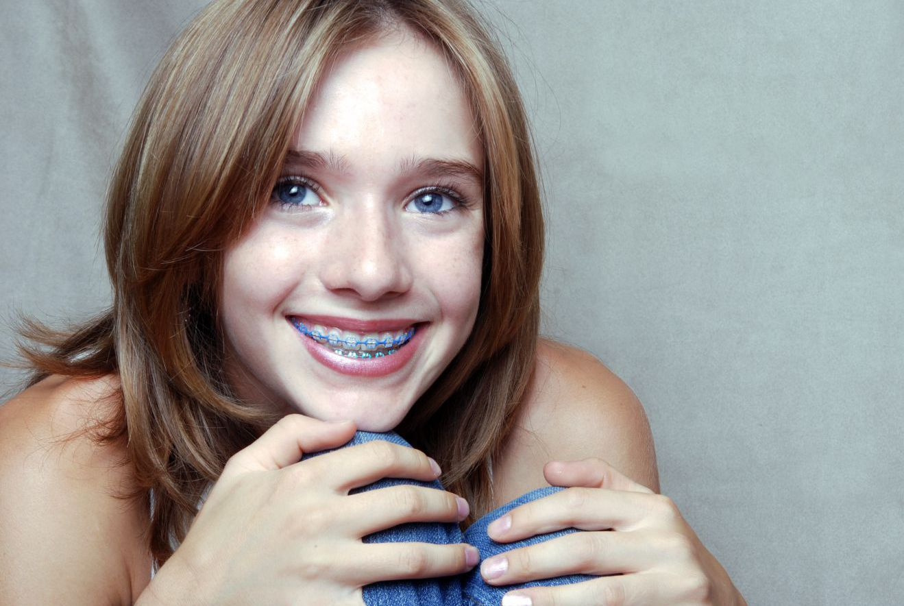 Happy young teenager with braces