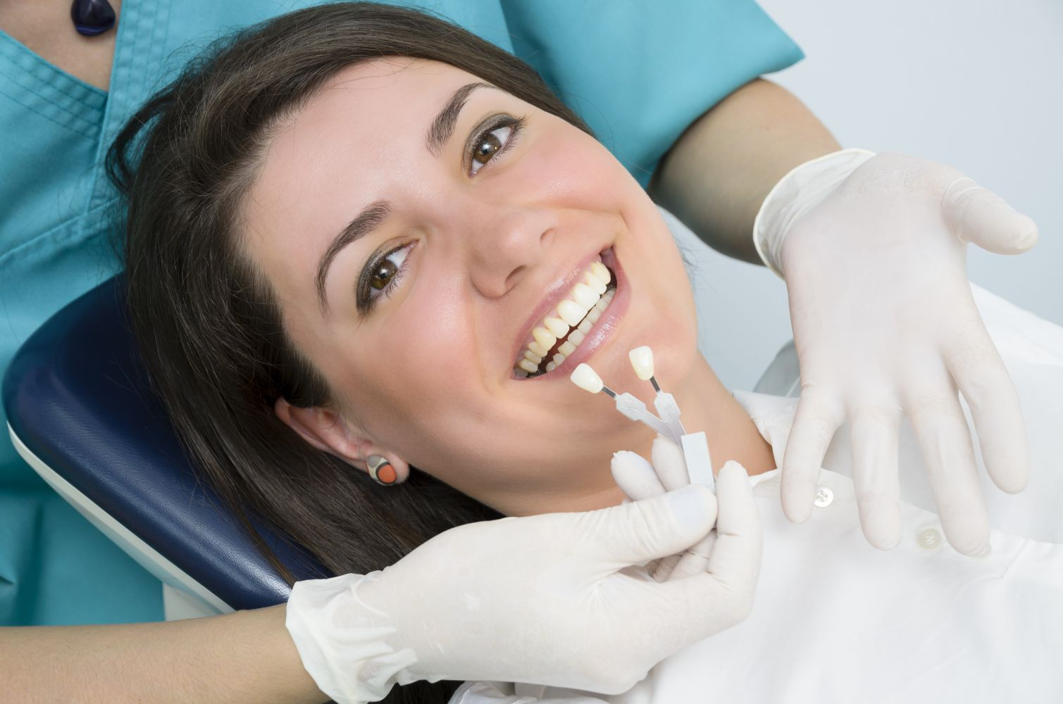 Happy young woman getting porcelain veneers
