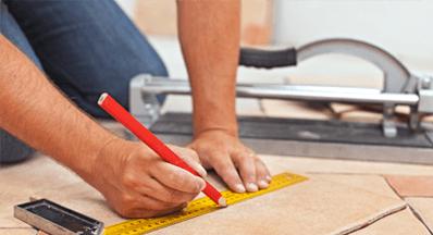 workman measuring tiles
