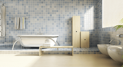 blue bathroom with tiled wall