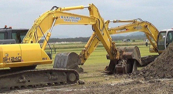 Excavators being used by pipeline contractors on the Sunshine Coast