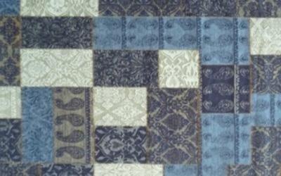 Tende di patchwork in tonalità blu