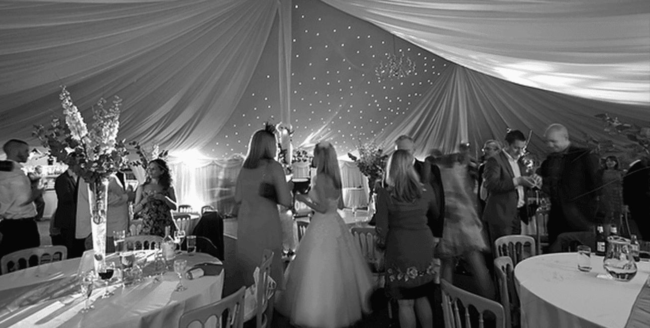 people talking at a wedding