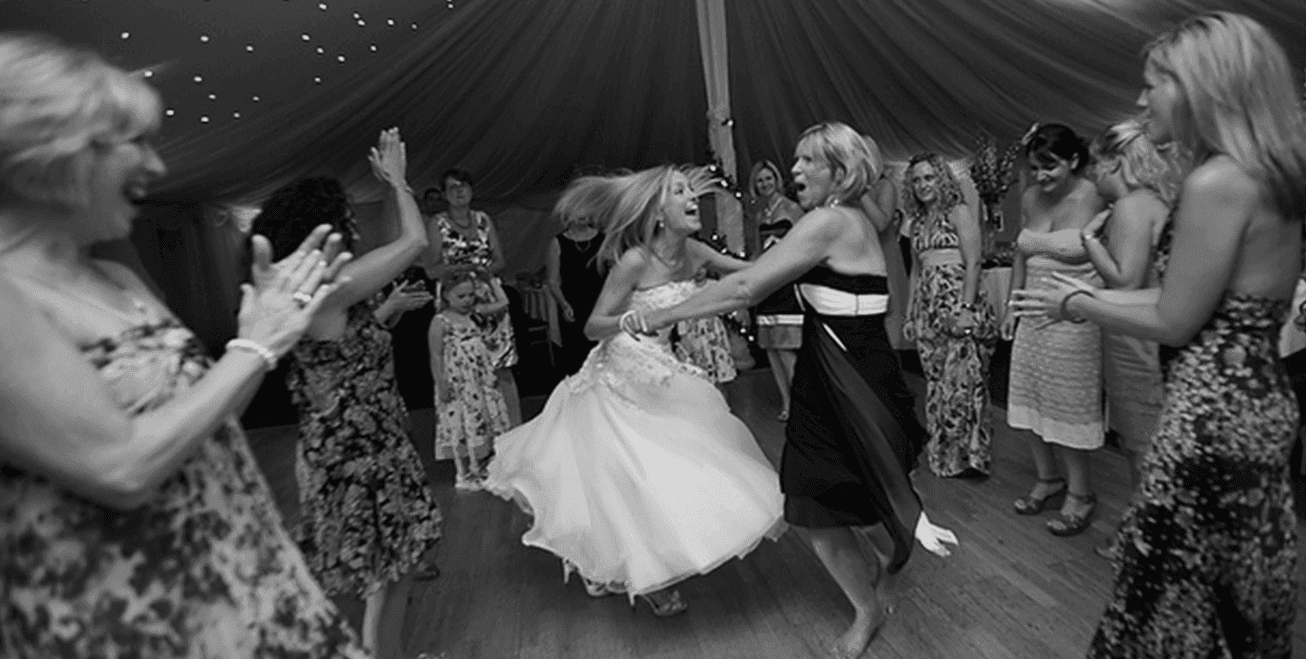 bride dancing with other woman