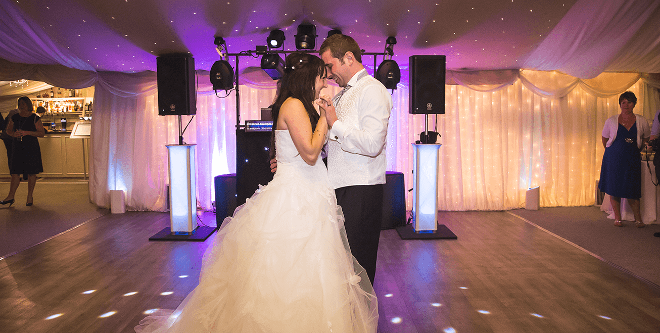 bride and groom dancing together