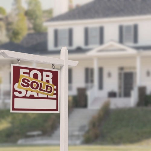 image of a house with a sold sign in front of it