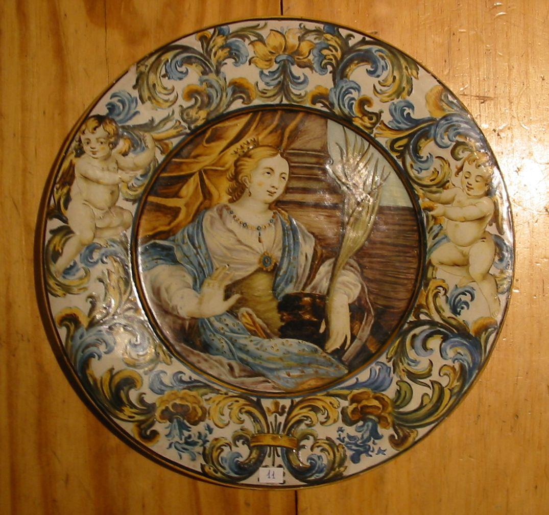 153) Piatto in Maiolica di Castelli C.A. Grue  S. Caterina. cm. 30,5