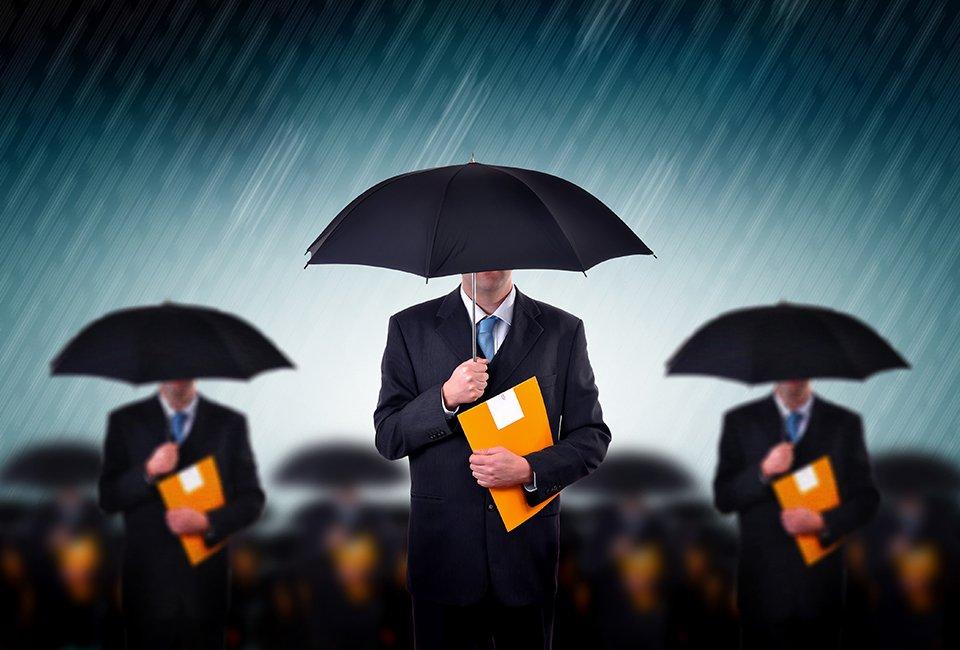 Professionals walking with umbrella