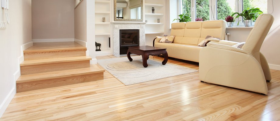 a cream livingroom with polished floorboards