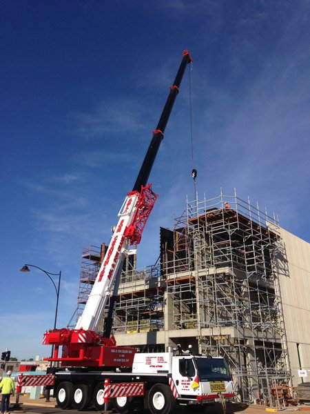 crane at three story building