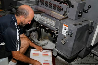 worker taking out prints