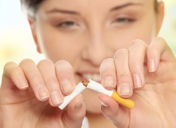 woman-breaking-cigarette-350