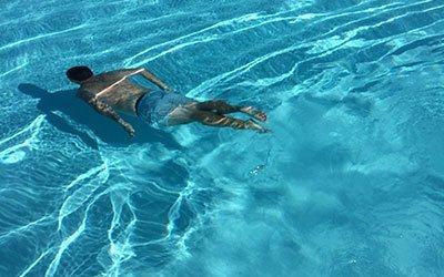 man-swimming-underwater
