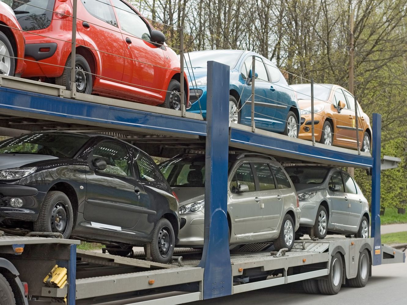 Cars carried on auto towing truck in Carthage, OH