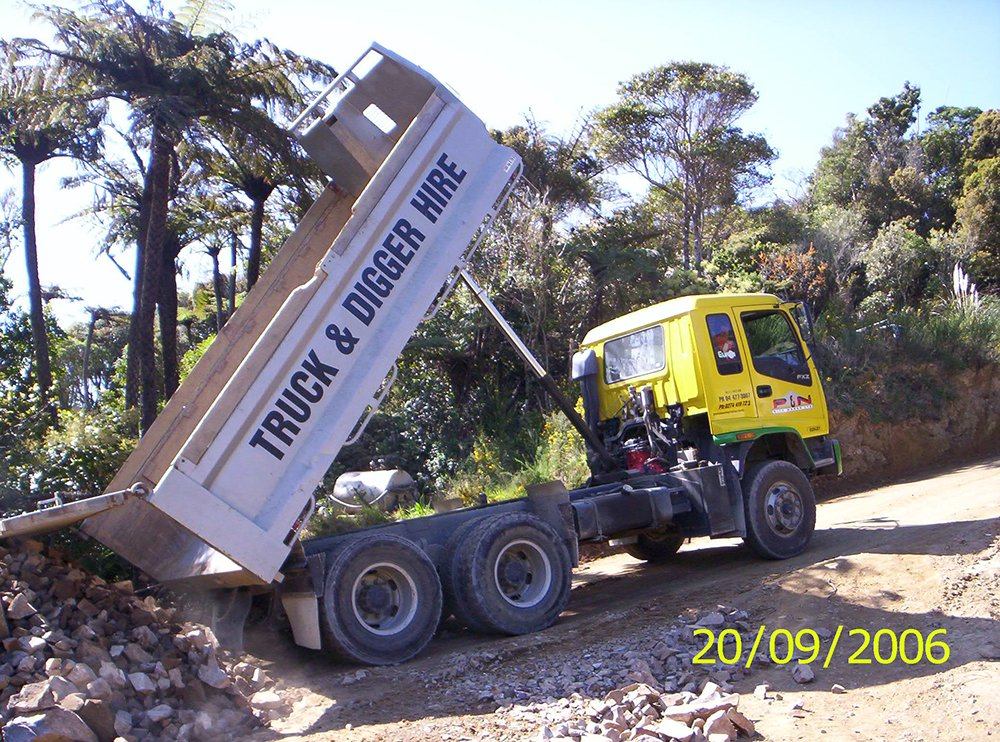 View of the truck dumping stones at the project site