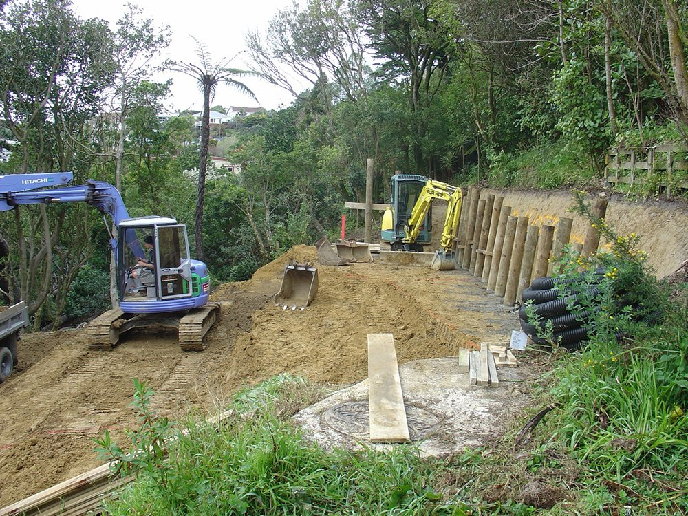 Earth being dig and a wall being constructed