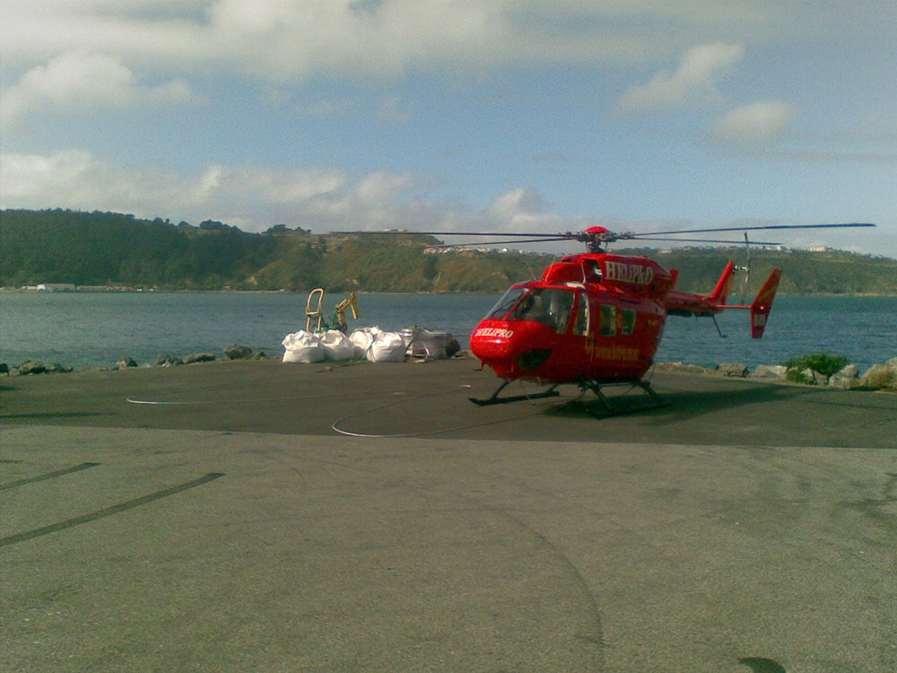 Helicopter landing on the ground near the project site