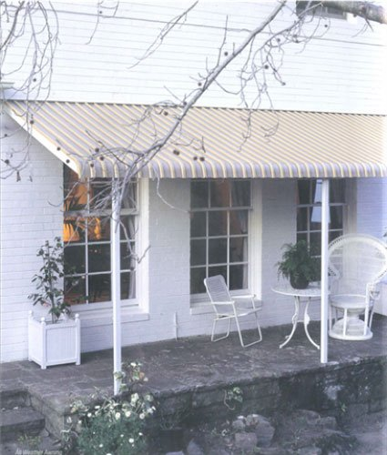 white house tan aluminium awning