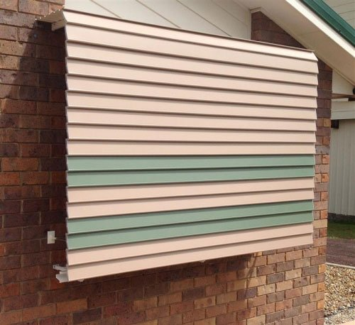 green and tan aluminium awning
