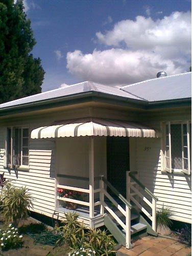 white and green porch and aluminium awning