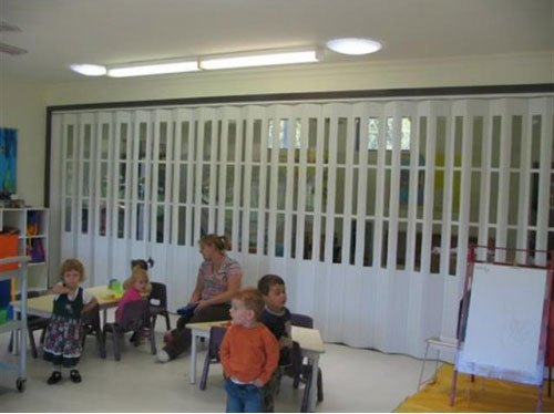 children with a folding door background