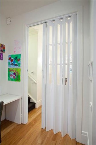 white door with painting on walls