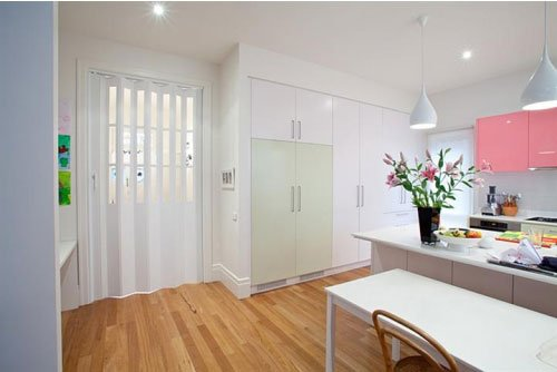 white kitchen with folding door