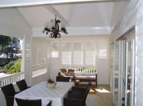 enclosed patio with plantation shutters