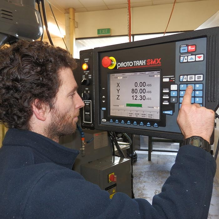 man operating industrial machinery