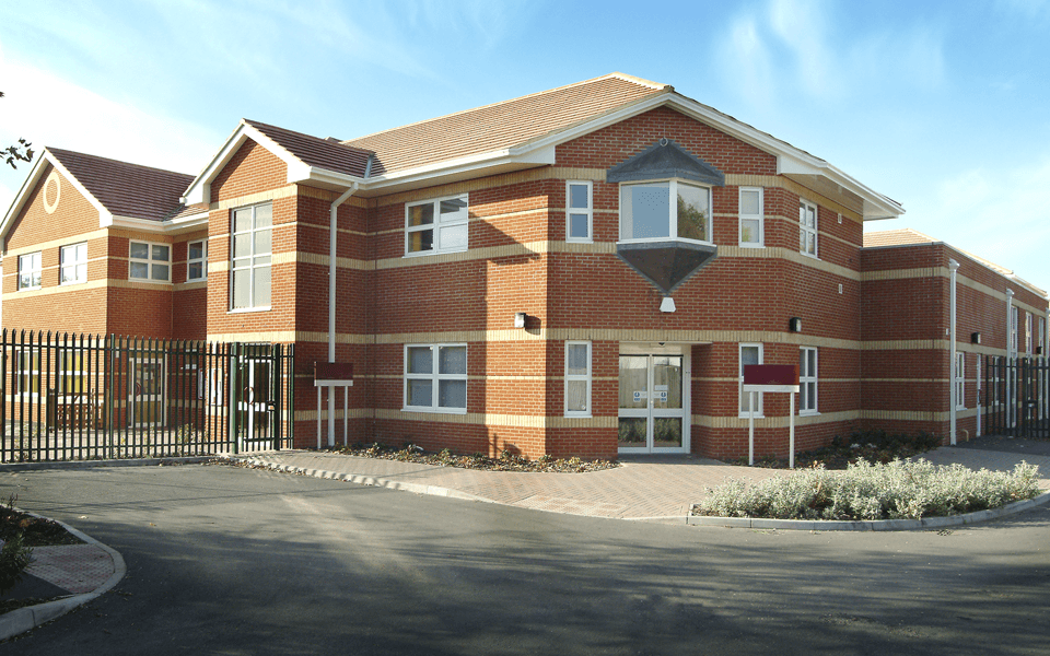 A large commercial red brick building