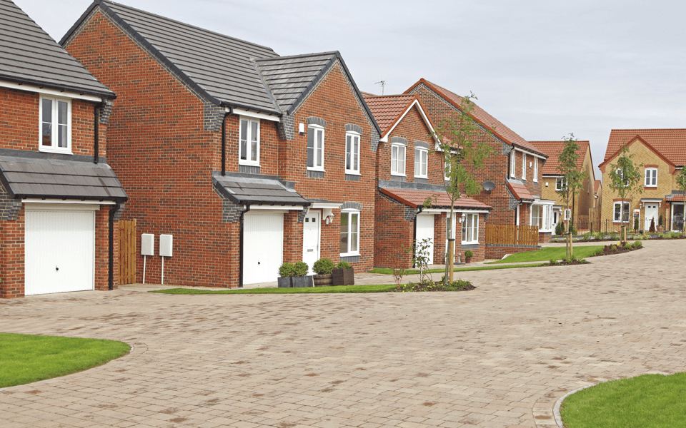 A new housing development with rows of neat, red brick homes