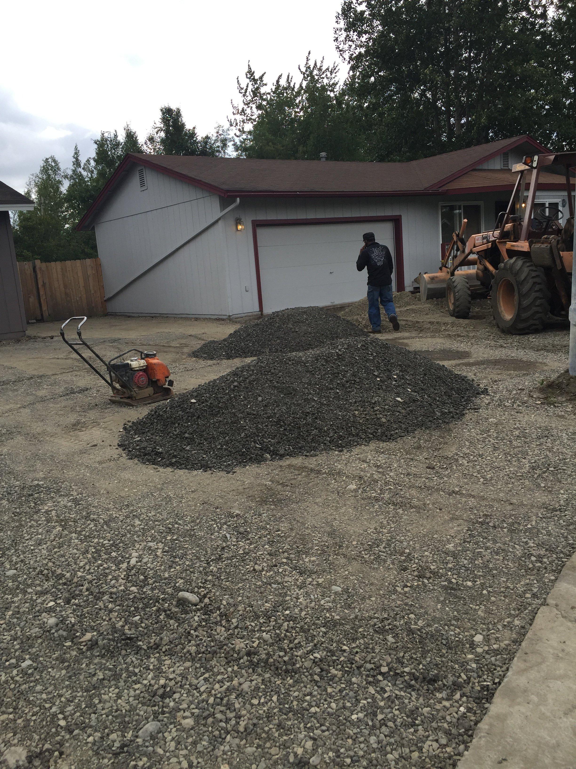 preparing the ground for asphalt