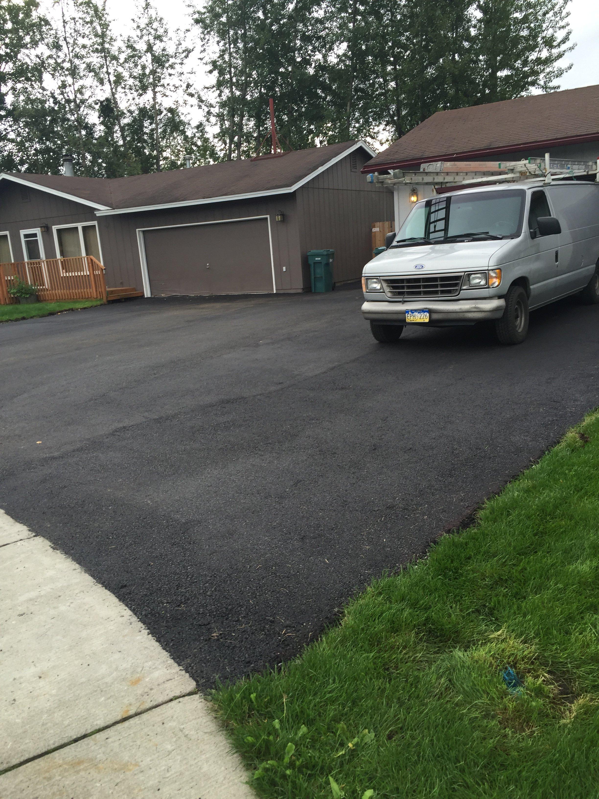 newly paved asphalt driveway