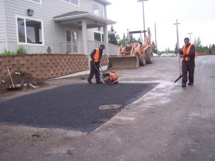 patting down the asphalt