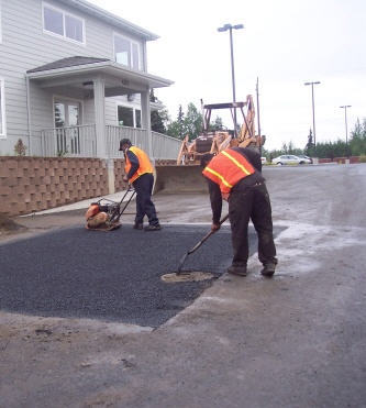 smoothing out the asphalt