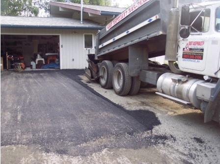 laying asphalt in driveway