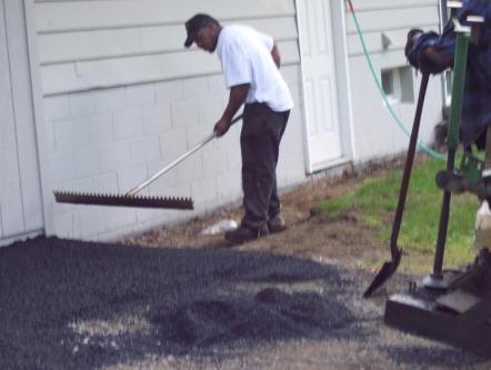 spreading the asphalt