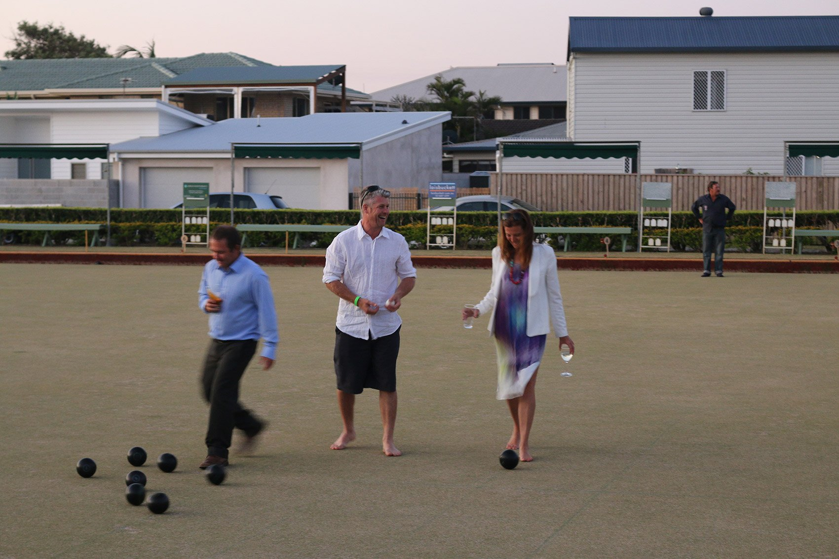 friends playing lawn bowls