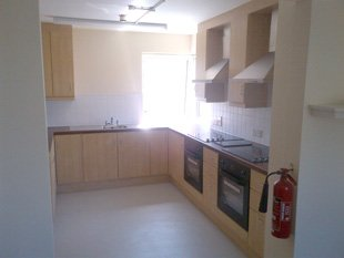 New kitchen with appliances and fire extinguisher