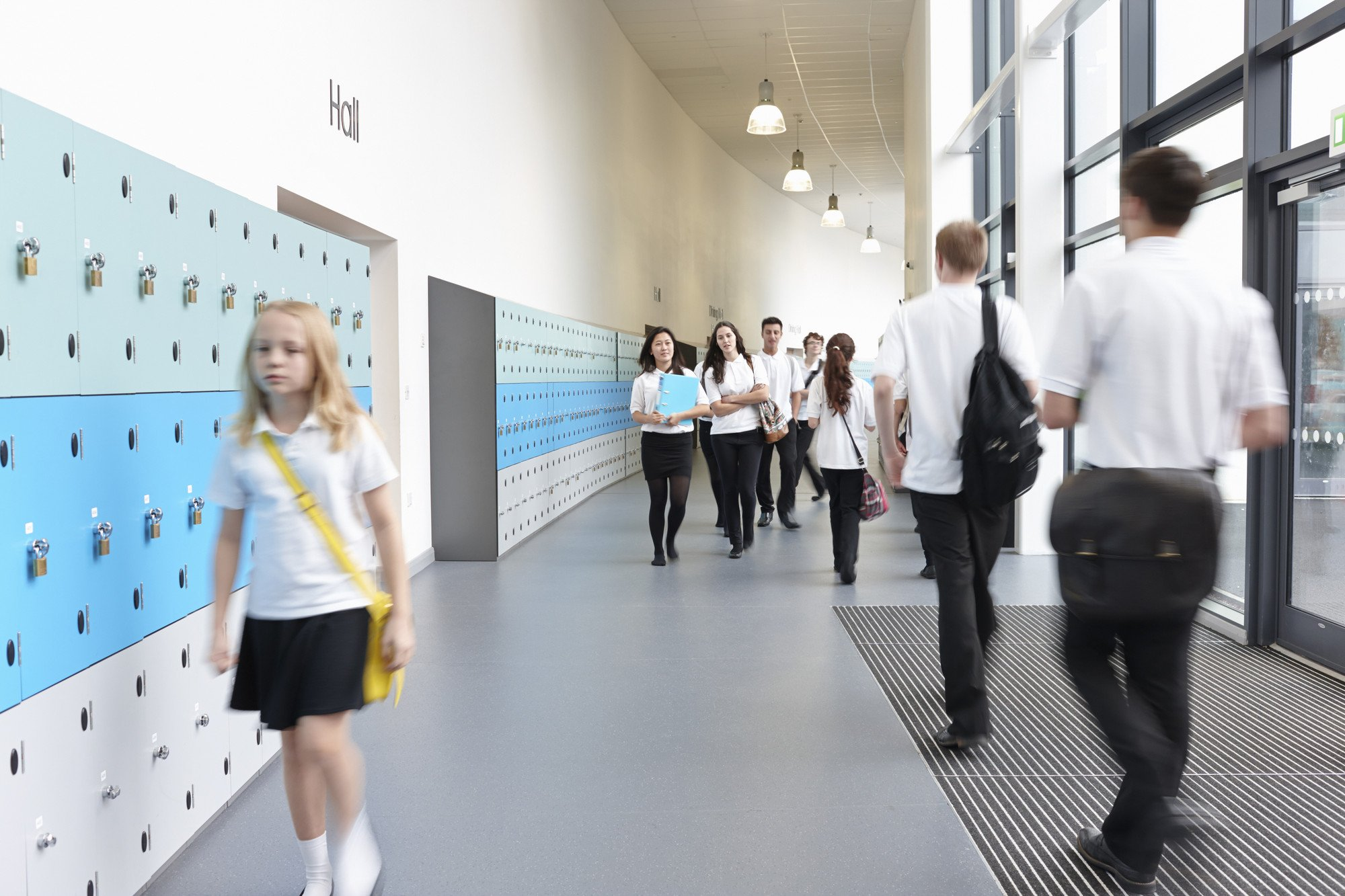 School hallway with students walking through it
