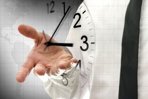 Businessman navigating virtual clock in interface - concept of time