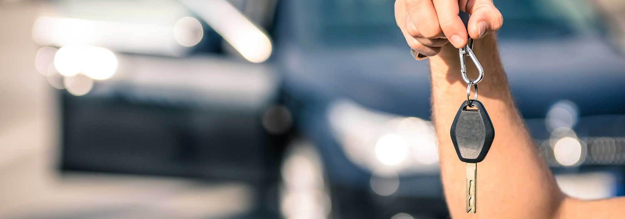Locksmith holding a car key in San Marcos, TX